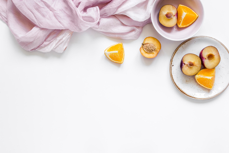 tropical peach and orange fruits for fresh juice with towel white background top view space for text Stok Fotoğraf