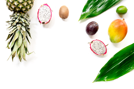 Exotic fruits food concept. Mangosteen, dragonfruit, mango, kiwi, pineapple on white background top view copyspace