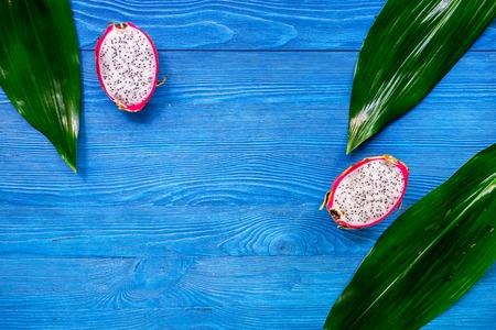 Dragonfruit on blue wooden desk background top view copyspace Stock Photo