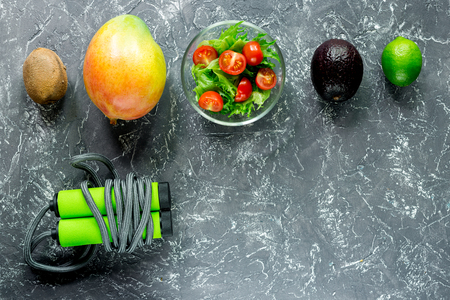 Healthy diet. Salad with fresh products and fruits mango, mangosteen, kiwi on stone table top view copyspace Stock Photo