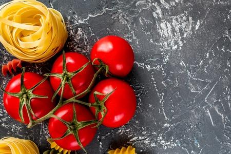Italian food concept pasta ingredients on grey stone desk background top view copyspace.