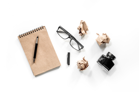 Writer concept. Vintage notebook, crumpled paper and glasses on white background top view Stock Photo