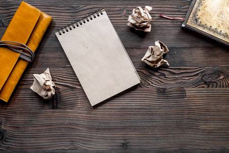 Writer concept. Vintage notebook and crumpled paper on wooden table background top view copyspace. Stock Photo - 80979191