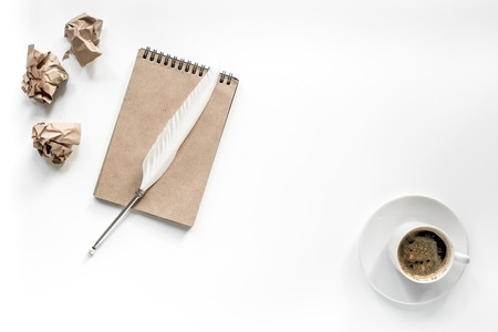 Writer concept. Feather pen, vintage notebook and crumpled paper on white background top view. Stock Photo