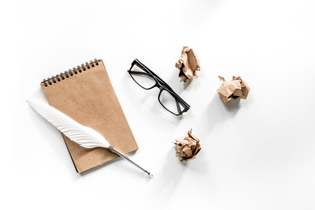 Writer concept. Feather pen, vintage notebook and crumpled paper on white background top view. Stock Photo - 81105936