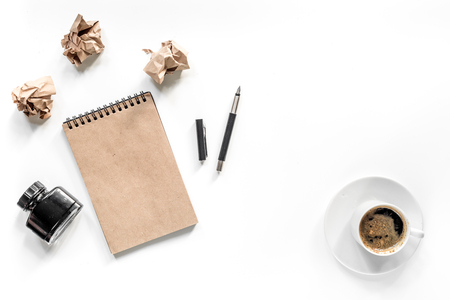 Writer concept. Vintage notebook, pen and crumpled paper on white background top view copyspace mock-up Stock Photo - 81274304