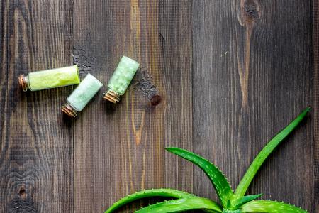 Organic aloe vera cosmetics. Aloe vera leafs and spa salt on wooden table background top view. Stock Photo
