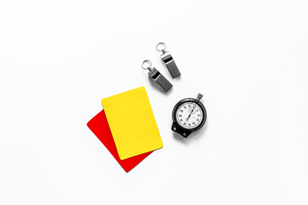 Yellow and red cards, stopwatch, whistle on white background top view copyspace. Stock Photo
