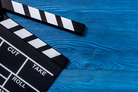 Movie clapperboard on wooden table background top view copyspace. Imagens - 81274192