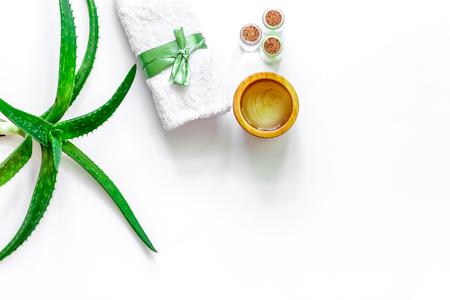 Skin care. Aloe vera gel and aloe vera leafs on white background top view copyspace
