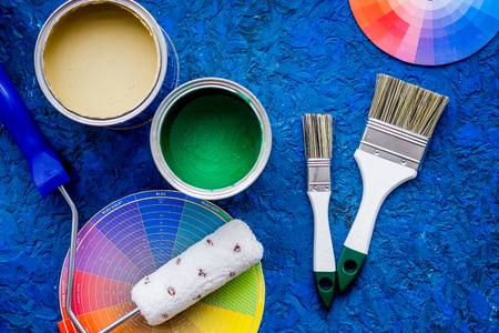 home decorating: Set of tools for painting on blue wooden desk background top view Stock Photo