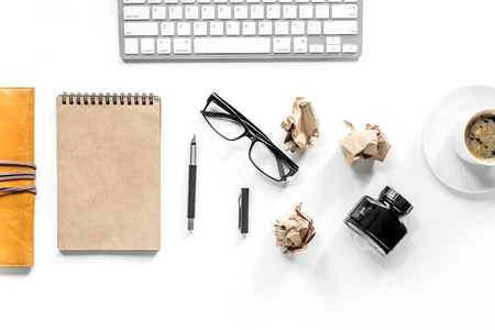 Writer workplace with keyboard, vintage notebook, glasses and coffee on white background top view mockup Stock Photo