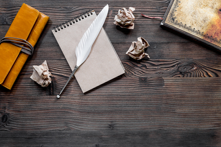 Writer concept. Feather pen, vintage notebook and crumpled paper on wooden table background top view copyspace Stock Photo - 81371386