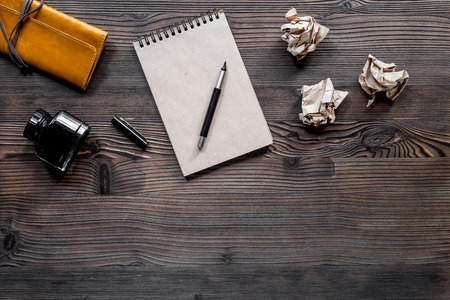 Writer concept. Pen, vintage notebook and crumpled paper on wooden table background top view copyspace Stock Photo - 81347465