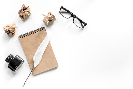 Writer concept. Feather pen, vintage notebook and crumpled paper on white background top view copyspace Stock Photo