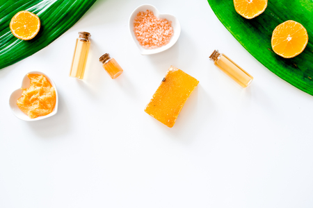 Aroma spa set. Citrus scrub, soap, salt and lotion on white background top view copyspace Reklamní fotografie