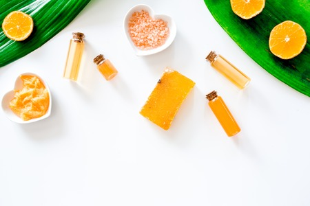 Aroma spa set. Citrus scrub, soap, salt and lotion on white background top view.