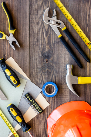 home decorating: Reparing home concept. Tools on wooden desk background top view copyspace