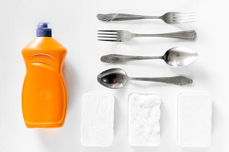Dishwashing liquid and sponge on white background top view. Stock Photo