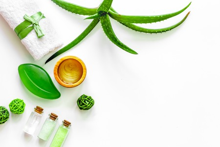Skin care. Aloe vera gel and aloe vera leafs on white background top view. Stock Photo