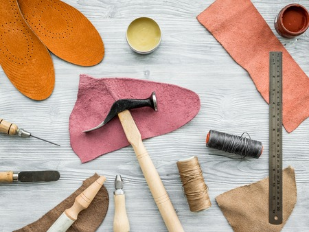Work desk of clobber. Skin and tools on grey wooden desk background top view. Stock Photo