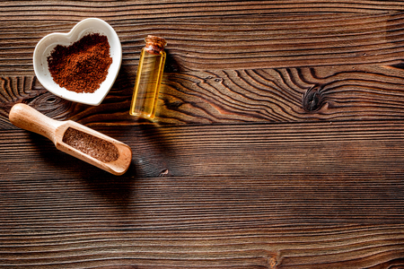 Aroma spa set. Coffee spa salt, oil on wooden table background top view.