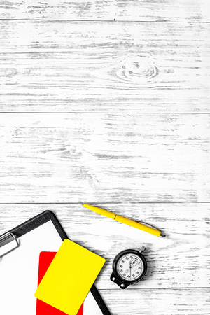 Referee tools. Yellow and red cards, stopwatch, whistle on wooden background top view copyspace.