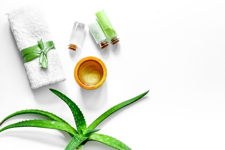 Aloe vera gel and aloe vera leafs on white background top view.