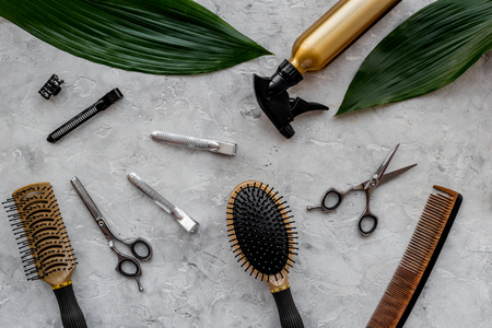 Beauty saloon. Haidressing tools on grey table background top view. Banco de Imagens