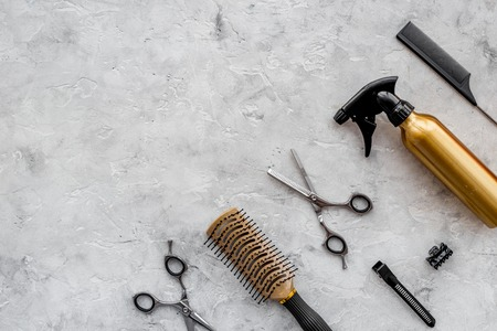 Beauty saloon. Haidressing tools on grey table background top view. Stock Photo