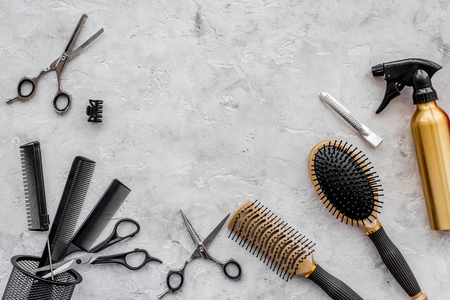 Hairdresser workplace. Combs and sciccors on grey table background top view. Stock Photo - 81998968
