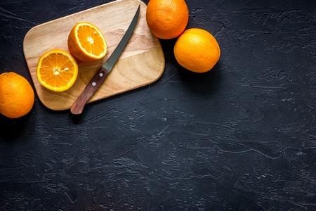 Citrus concept. Fresh oranges on black table background top view copyspace