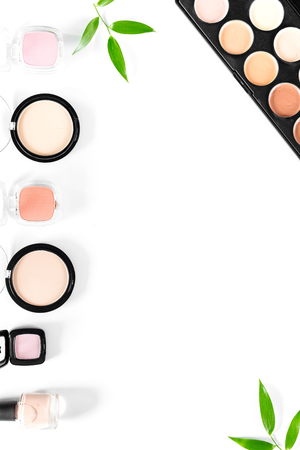 Makeup kit. Eyeshadows, blushes on white table background top view. Фото со стока