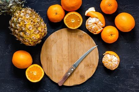 Citrus concept. Fresh oranges on black table background top view. 版權商用圖片