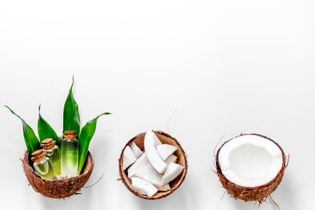 Body treatment. Coconut cosmetics on white background top view copyspace.