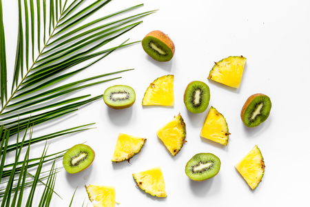 Concept of summer tropical fruits. Pineapple on table background top view. 版權商用圖片
