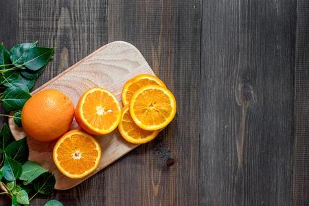 Citrus concept. Fresh oranges on wooden table background top view. Banco de Imagens - 82284063