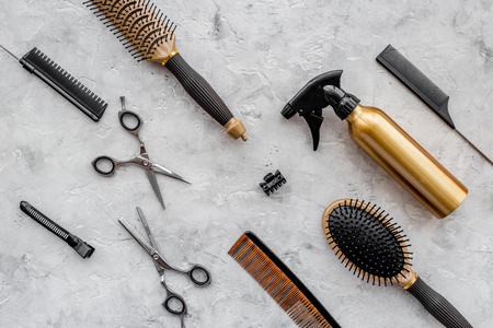 Pattern of combs and hairdresser tools on grey table background top view. Stock Photo