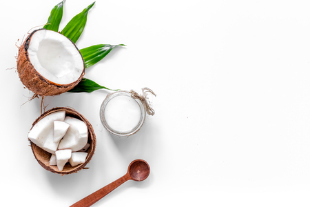 Coconut cosmetics on white background top view