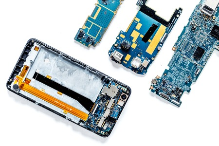 Parts of disassembled cell phone on white background top view copyspace