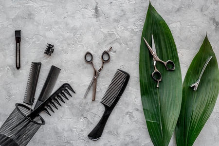 hair stylist: Beauty saloon. Haidressing tools on grey table background top view. Stock Photo