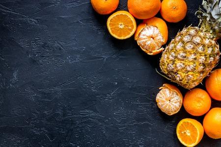 Citrus concept. Fresh oranges on black table background top view. Banco de Imagens