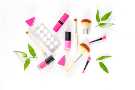 Contents of wonams beauty bag. Cosmetics, contraceptives and pills on white background top view copyspace