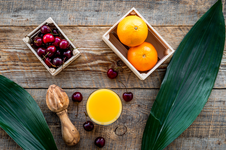 Fruits for breakfast. Oranges and cherry on wooden table background top view Banco de Imagens