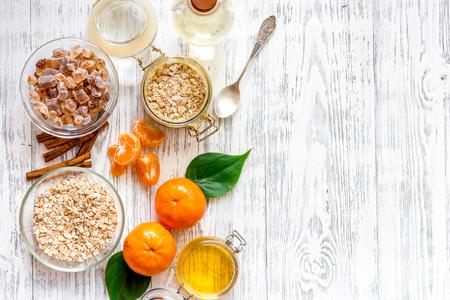 Preparing healthy breakfast with oranges on light wooden table top view copyspace Banco de Imagens