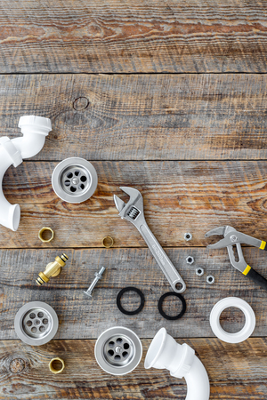 Plumber tools on wooden background top view copyspace 版權商用圖片
