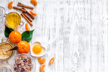 Preparing healthy breakfast with oranges on light wooden table top view.