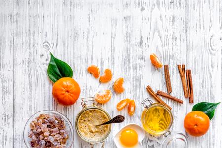 Preparing healthy breakfast. Cereals with oranges, honey, cinnamon on wooden table background top view copyspace