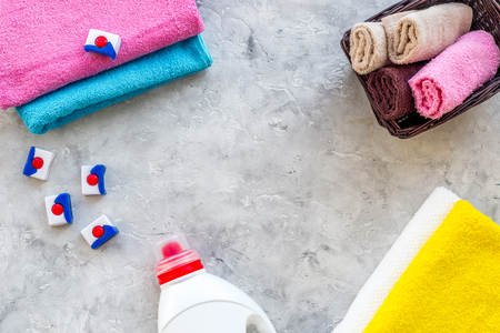 Wash clothes. Clean towel and detergent on grey stone background top view copyspace Stock Photo