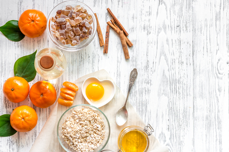 Preparing healthy breakfast with oranges on wooden table background top view.